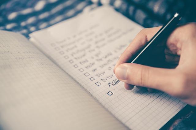 Writing a checklist into a notebook